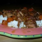 Louisiana Beef Stew - Beef stew with tomatoes, carrots and raisins, flavored with molasses and served with steamed rice.