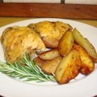 Crispy Rosemary Chicken and Fries - This is a one pan meal that's in the oven in 15 minutes. Rosemary, garlic, and oregano create a mouth watering aroma and the potatoes are crispy like french fries. Kids just love this!