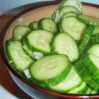 Mom's Cucumbers - Thin, thin cucumbers are doused with sugar, water, vinegar, celery seed and onion, and chilled for an hour or so. Great as a salad or as open face sandwiches on pumpernickel bread.