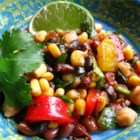 Bean Salad - A spicy bean salad with a kick of lime that is great as a side dish, nacho topping, or all on its own!