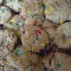 Delicious Christmas Cookies - This family recipe combines graham cracker crumbs, flour, sweetened condensed milk, butter, coconut and candy-coated chocolates.  They just might become a tradition in your family too!