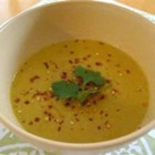 Coconut Curry Pumpkin Soup - This vegan version of pumpkin soup uses coconut oil instead of butter and light coconut milk in place of milk or cream. Seasoned with curry powder, coriander, red pepper flakes, garlic and onion, it's easy to make and can be a terrific starter or a small meal on its own.