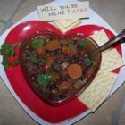Spicy Black Bean Soup - Black beans, ham, and aromatic vegetables are simmered in a beef bouillon seasoned with ground mustard, oregano, thyme and cayenne pepper.
