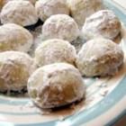 Italian Wedding Cookies III - Also sometimes called 'Mexican wedding cookie', 'Russian tea cakes',  or 'butterballs', can also be made into crescents. You can also substitute pecans and they are very good as well.  This is the best version of these I have ever seen, it was given me by a friend who grew up in central Europe.