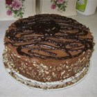 Chocolate Mousse Cake II - Very rich chocolate mousse over a rich chocolate cake layer and topped with chocolate ganache sauce and chopped nuts. Great for special occasions. This cake takes TIME to make, and TIME to set. It's worth every second of preparation, and is a hit every time!