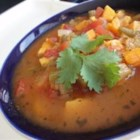 Sweet Potato Minestrone - A hearty soup of sweet potatoes, carrots, green beans, celery, tomatoes, onions and garlic.