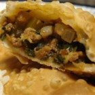 Puerto Rican Meat Patties - Sauteed and seasoned ground beef is enclosed in egg roll wrappers, and deep fried. Wonton wrappers could be used instead, to make smaller cocktail appetizers.