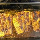 Cajun Blackened Redfish - Red drum fish, a type of bass, is coated with cayenne pepper, black pepper, lemon pepper and garlic powder; baked in Italian dressing.