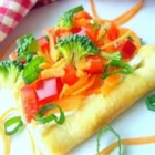 Garden Veggie Pizza Squares - Pre-packaged crescent roll dough gets baked into a single rectangle, then topped with ranch dressing-spiked cream cheese and crunchy vegetables.