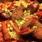 Fried Corn with Smoked Sausage - This delicious recipe combines corn, onions, green and red bell peppers, and smoked sausage in a delicious one-pot meal.