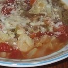 Italian Riboletta Soup - Riboletta, roughly translated in Italian, means re-boiled minestrone soup with bread slices in it.  This is an excellent version, brimming with vegetables, and baked for the final 30 minutes of cooking with parmesan toasts nestled on top.