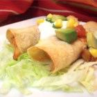 Chicken Flautas - Lightly crisped corn tortillas are stuffed with a zesty chicken and cheese filling.