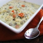 Creamy Chicken and Wild Rice Soup - Instant wild rice is cooked in chicken broth with shredded chicken, then combined with thickened cream for a quick soup.