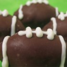 Cookie Balls - Chocolate sandwich cookie crumbs are combined with cream cheese and dipped in candy coating.