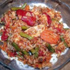 Jollof Rice - Popular and spicy West African chicken and rice dish - this is a one pot meal with chicken, rice, fresh green beans, onions, and carrots all stewed together with fresh rosemary, red pepper flakes, and nutmeg.
