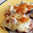 Lobster Thermidor - This stunning lobster dish is surprisingly simple to make. Lobster shells are stuffed with cooked lobster in a creamy white wine sauce, then topped with Parmesan cheese and broiled until golden.