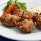 Jamaican Saltfish Fritters  (Stamp and Go) - A popular Jamaican appetizer, these fried salted cod cakes can be made in any kitchen.  Just stamp them out in the kitchen, take some for the road and go! Codfish can be prepared the day before for a quicker cook time. These are also good served with a spicy dipping sauce.