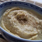 Easy Hummus - I make this hummus all the time. It only takes a few minutes to prepare, and it's healthier without the oil. Increase or decrease the ingredients as desired, especially the jalapenos! Serve with pita chips or fresh veggie slices. Add more of the reserved bean liquid for a smoother dip.
