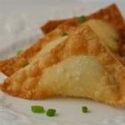 Crab Rangoon - Wonton wrappers are filled with seasoned cream cheese and crab to make these crispy little baked appetizers.