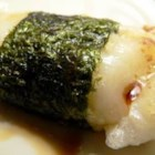 Broiled Mochi with Nori Seaweed - Sweet, sticky rice cake squares are dipped in soy sauce and wrapped in strips of dried seaweed to make a delectable Japanese treat.