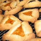 Easy Purim Hamentashen - Fat little triangle-shaped cookie purses hold a treasure of prune or apricot filling. Make the dough with butter and milk for milchig, or substitute margarine and orange juice for pareve. They're traditional for Purim. You can make and chill the dough ahead of time to make your life easier.