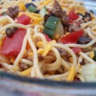 Sausage Pasta - Savory pork sausage and pasta with olives, tomatoes and cheese.