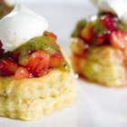 Strawberry Kiwi Tartlets - Glazed strawberries in puff pastry shells, topped with kiwi sauce and home made whipped cream. I always see strawberry and kiwi paired together in drink mixes and candies. I wanted to make something that used the actual fruits together. This worked perfectly. Rave reviews!