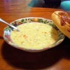 Chicken Cheese Chowder - This rich stew incorporates chopped cooked chicken and vegetables in a creamy soup base with processed cheese and soy sauce.