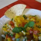 Caribbean Fruity Salsa - This three-fruit salsa is sweet and spicy at the same time.  It makes a wonderful accompaniment to grilled fish or chicken, is perfect served with tortilla chips, and can even be served with granola and yogurt for breakfast!