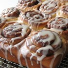 Clone of a Cinnabon - Save yourself a lot of money by making your own homemade cinnamon rolls! The dough is made in the bread machine and everything else is done by hand.