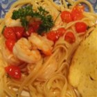 Shrimp Scampi with Linguini - This recipe results in lots of garlicky shrimp tossed with some linguine, white wine, and lemon juice.