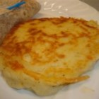 Potato Cake - Great for breakfast! Leftover mashed potatoes are fried into pancakes with a cheese surprise in the middle.