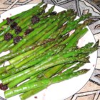 Divine Asparagus - A divine side dish for almost any main dish. Asparagus sauteed in garlic butter, then finished off with a red wine and raisin sauce. Quick and easy (Isn't this what we're are all looking for?)!