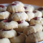 Raspberry and Almond Shortbread Thumbprints - Shortbread thumbprint cookie filled with raspberry jam, and drizzled with glaze.