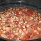 CB's Black Eyed Peas - Make these black-eyed peas, seasoned with bacon, tomatoes, and chili powder, in your slow cooker. They're perfect for New Year's Day, or whenever you want an easy, hearty meal.
