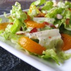 Romaine and Mandarin Orange Salad with Poppy Seed Dressing - Crisp romaine, crumbled bacon, mandarin orange segments, toasted almonds, and a homemade vinaigrette make this green salad a standout.