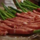Green Onion Wraps - This is a fun appetizer for those that enjoy flavor and zing.  Fresh green onions are wrapped in cream cheese and corned beef slices. It's very easy to make and can be done ahead of time.  Served on a colorful flat dish, they are very showy. They make a lovely addition to a spicy or deli-style meal.
