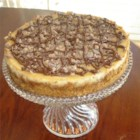 Toffee Bar Cheesecake - A rich cheese cake with chocolate and caramel bits. Goes great with a nightcap.