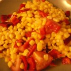 Corn Tomato Salad - This simple recipe is a great use for leftover sweet summer corn on the cob. Light and quick, it's a great addition to summer meals.