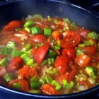 Okra and Tomatoes - Okra is sauteed in bacon grease with onion, green pepper, celery, and stewed tomatoes in this simple side dish.