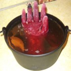 Witches' Brew - A fun Halloween attention-getter. Great for parties. A fake hand is frozen in a disposable glove and then slipped into the punch bowl!