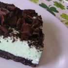 Creme de Menthe Grasshopper Pie - A fluffy, minty, frozen pie with a chocolate sandwich cookie crust. It's easy to prepare and has a festive color.