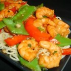 Sesame Shrimp Stir-Fry - This quick and tasty main dish has a double hit of sesame oil and seeds that add nutty flavor to crisp peppers and shrimp.
