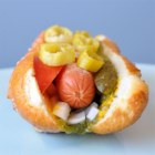 Chicago-Style Hot Dog - An all-beef hot dog on a poppy seed bun piled high with mustard, sweet pickle relish, onion, tomato, a dill pickle spear, sport peppers, and a dash of celery salt.  Don't even think about ketchup!