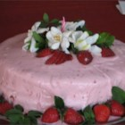 Strawberry Dream Cake II - A white cake mix is livened up with mashed strawberries and strawberry-flavored gelatin, then baked in three 9-inch pans. It is then frosted with Strawberry Cream Cheese Frosting.