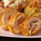 Cordon Bleu Chicken Rolls - Breaded chicken stuffed with ham and cheese sounds pretty pedestrian, but it tastes extraordinary.  This recipe includes an easy cream sauce to boot.