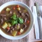 Beef Stew IV - Browned beef is seasoned with paprika and simmered with onions, carrots, potatoes and frozen corn kernels.