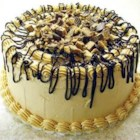 Peanut Butter Cake II - If you like peanut butter without chocolate, you will love this cake. If you don't have cream, you may substitute milk.