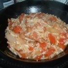 Spanish Rice I - This is a quick and easy way to spice up rice.  Saute instant rice with onion, red bell pepper and green bell pepper.  Then simmer with tomatoes and tomato juice and you've got a savory Spanish-style rice.