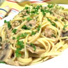 Linguine with Clams - Chopped clams and mushrooms simmered in white wine and butter with garlic and a touch of sour cream. Tossed with linguine pasta and served with a side salad and French bread, you'll have yourself a meal to remember!